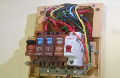Switchboard exposed and has no cover. Insufficient bus bar for both Earth and Neutral wire where wires are just connected together by twisting and connector.